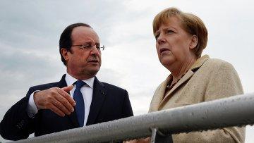 Канцлер Германии Ангела Меркель и президент Франции Франсуа Олланд во время неформальной встречи, 10 мая 2014