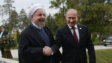 Президент России Владимир Путин и президент Ирана Хасан Рухани в Астрахани