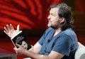 Сербский кинорежиссер Эмир Кустурица во время выступления на итальянском телеканале в Милане. 2011