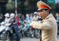 Дорожный полицейский в Ханое, Вьетнам