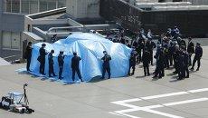 Купол над дроном, приземлившимся на крышу резиденции премьер-министра Японии Синдзо Абэ в Токио