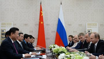Беседа Президента Российской Федерации Владимира Путина с Председателем Китайской Народной Республики Си Цзиньпином. Архивное фото