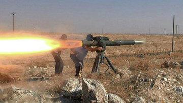 Боевики Исламского государства во время боя в районе города Хасеке на северо-востоке Сирии. Архивное фото