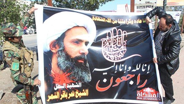Баннер с изображением казненного шиитского проповедника Нимра ан-Нимра, 3 января 2016. Архивное фото