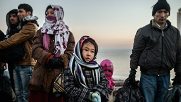 Сирийские беженцы на турецкой границе. Архивное фото