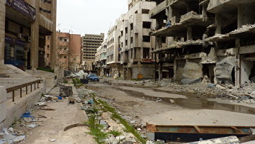Разрушенные в результате боевых действий здания в городе Хомс