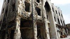Разрушенное в результате боевых действий здание в городе Хомс. Архивное фото