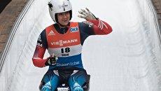 Татьяна Иванова (Россия) на финише заезда индивидуальных соревнований среди женщин. Архивное фото