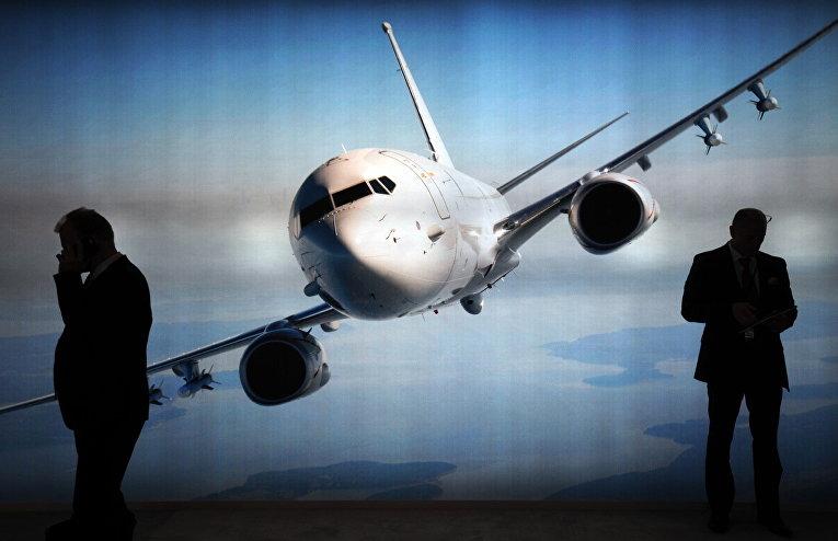 Стенд компании Boeing на авиашоу Singapore Airshow в Сингапуре
