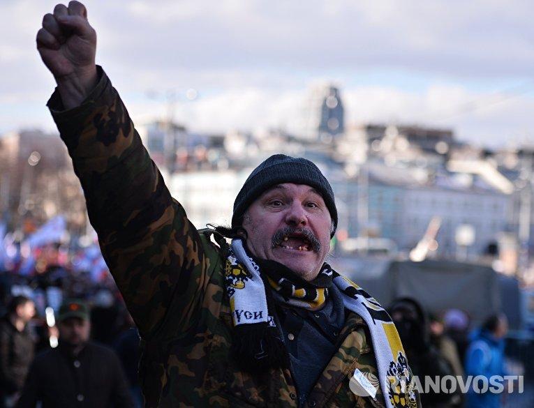 Участник марша памяти, посвященного годовщине гибели политика, общественного деятеля Бориса Немцова