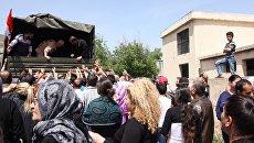 Раздача гуманитарной помощи в Сирии. Архивное фото