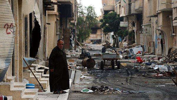 Мужчина на одной из улиц Пальмиры. Архивное фото