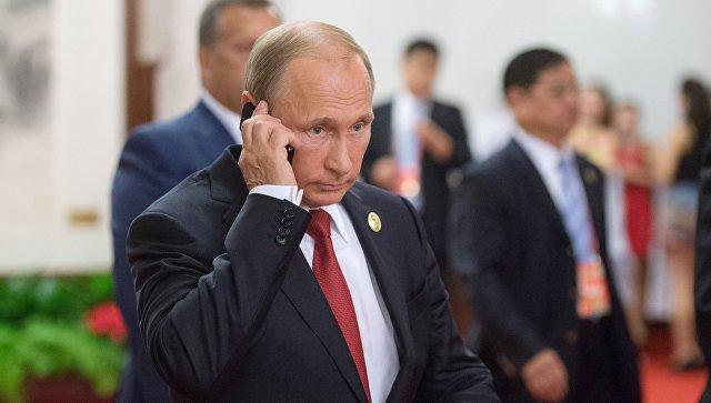 Путин по телефону обсудил с Роухани ситуацию в Сирии