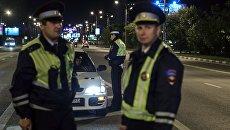 Сотрудники дорожно-патрульной службы