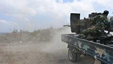 Вооружённые силы Сирии ведут боевые действия в пригородах Саламия, провинции Хама. Архивное фото