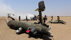 Обломки российского вертолета Ми-8, который был сбит в провинции Идлиб на севере Сирии. 1 августа 2016
