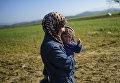 Беженцы в палаточном лагере на греко-македонской границе