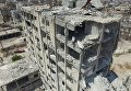 Разрушенное здание в квартале Бани-Зейд на севере Алеппо
