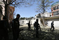 Афганские военные на месте теракта у здания гуманитарной организации CARE в Кабуле, Афганистан. 6 сентября 2016