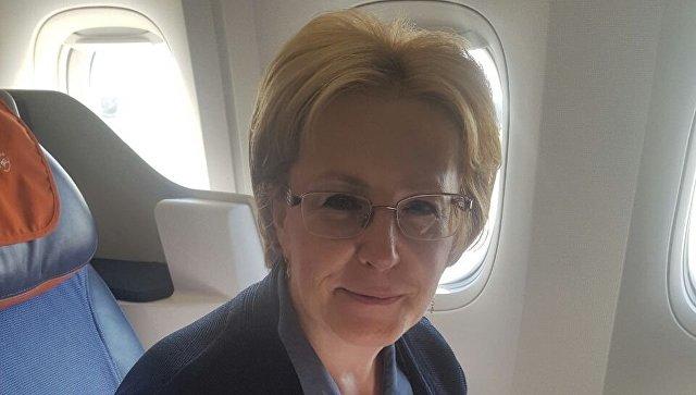 Министр здравоохранения России Вероника Скворцова в салоне самолета