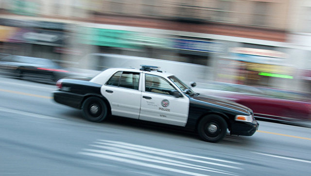 Машина полиции на улице в Лос-Анджелесе, США