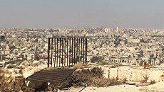 Захваченные боевиками восточные кварталы Алеппо. Вид из Цитадели в старом городе