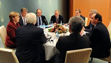 Президент РФ Владимир Путин, федеральный канцлер Германии Ангела Меркель и президент Франции Франсуа Олланд во время трехсторонней переговоров по ситуации в Сириив Берлине. 19 октября 2016