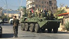 Агитационная бронемашина сирийской армии возле гуманитарного коридора Бустан аль-Каср в восточном Алеппо. Архивное фото