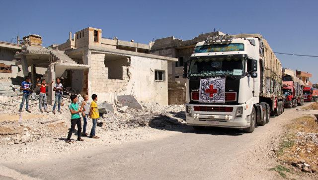 Колонна грузовиков с гуманитарной помощью ООН в Сирии. Архивное фото