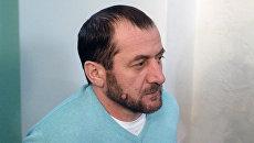 Хамзат Бахаев перед началом заседания по делу об убийстве Бориса Немцова в Московском окружном военном суде. Архивное фото