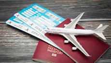 Авиабилеты и паспорта. Архивное фото