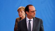 Президент Франции Франсуа Олланд и канцлер Германии Ангела Меркель на совместной пресс-конференции в Берлине. 13 декабря 2016 года