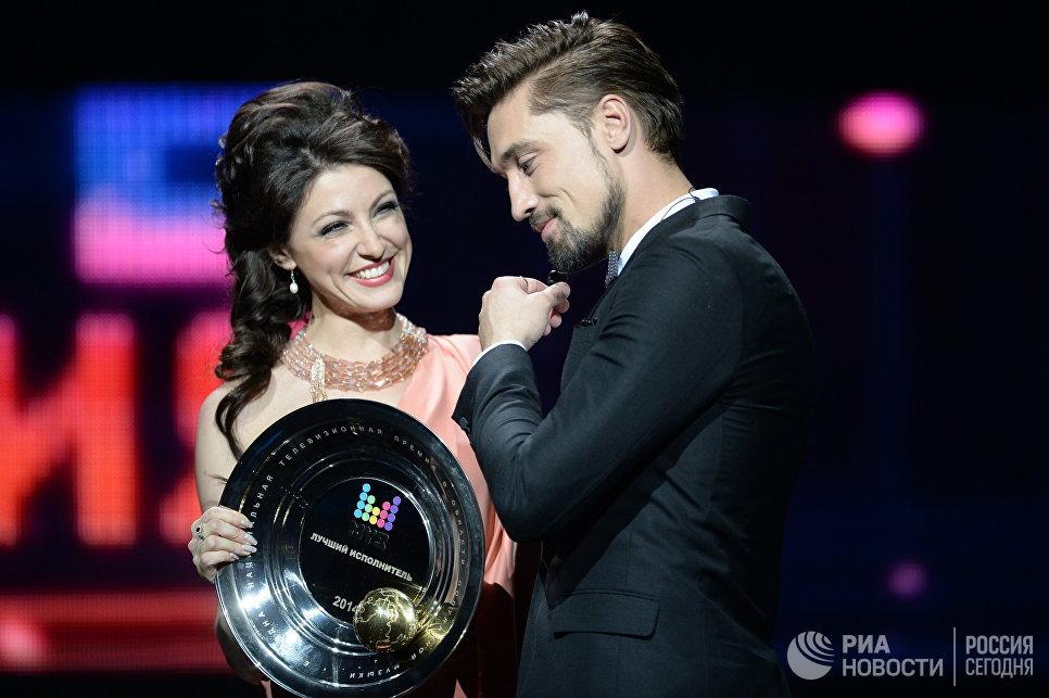Певец Дима Билан, получивший награду XII премии в области популярной музыки Муз-ТВ-2014. Эволюция в номинации Лучший исполнитель в Москве