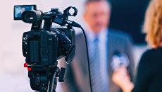 Телевизионное интервью. Архивное фото