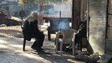 Жители Алеппо в освобожденных восточных кварталах. Архивное фото