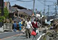 Жители поселка Масики после землетрясений в Японии. 17 апреля 2016