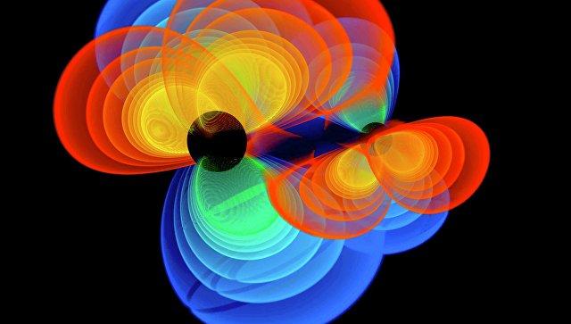 Так художник представил себе сливающиеся черные дыры и вырабатываемые ими гравитационные волны