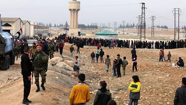Беженцы в пункте временного размещения Жибрин в Алеппо. Архивное фото