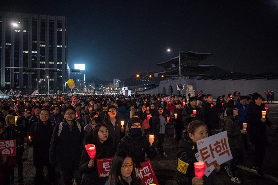 Около млн демонстрантов вСеуле требуют отставки президента Пак Кын Хе