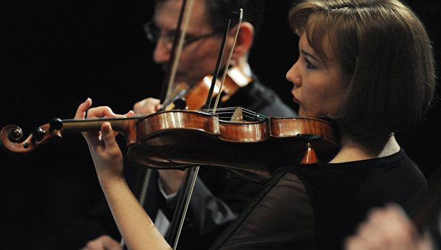 Музыканты Большого симфонического оркестра во время концерта. Архивное фото
