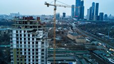 Строительство многоквартирного жилого дома в московском районе. Архивное фото