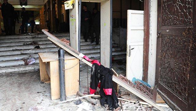 На месте взрыва у здания Дворца правосудия в Дамаске. 15 марта 2017