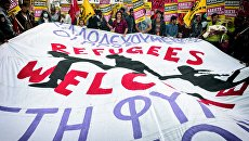 Акция протеста в поддержку мигрантов и с призывом отменить договоренность ЕС и Турции по беженцам в Афинах