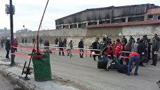 Вывод боевиков из квартала Аль-Ваер в сирийском городе Хомс. Архивное фото