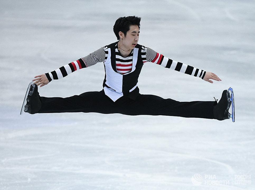 Цзинь Боян выступает в произвольной программе мужского одиночного катания на чемпионате мира по фигурному катанию в Хельсинки