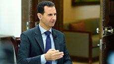 Президент Сирии Башар Асад во время интервью. Архивное фото