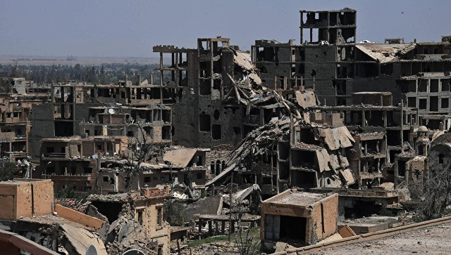 Разрушенные здания в сирийском городе Дейр-эз-Зор. Архивное фото