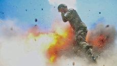 Снимок взрыва, сделанный военным фотографом Хильдой Клейтон за мгновение до смерти