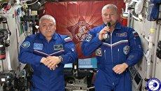 СКРИНШОТ ВИДЕО. Поздравление с Днем Победы с борта МКС
