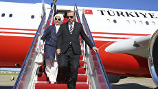 Президент Турции Реджеп Тайип Эрдоган с супругой в аэропорту Вашингтона. 15 мая 2017 года